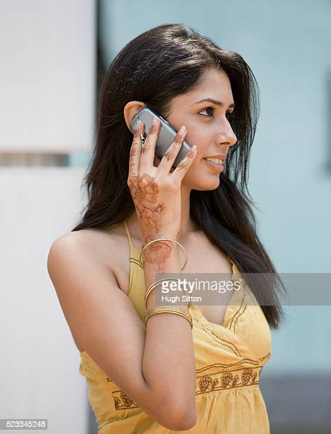 woman on cell phone - hugh sitton india stock pictures, royalty-free photos & images