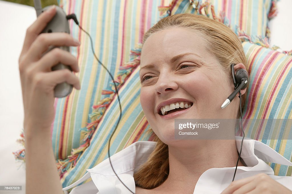 Woman on cell phone with headset : Stockfoto