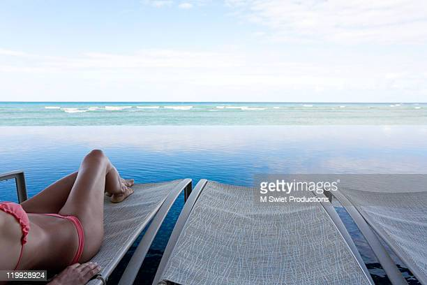 Woman on chaise lounge