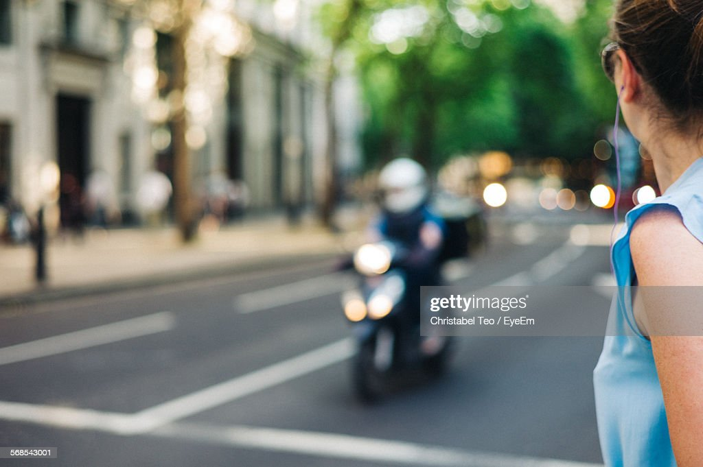 Woman On City Street By Building : Stock Photo