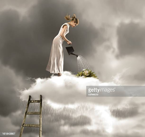 Woman on cloud watering plants with rain falling from cloud