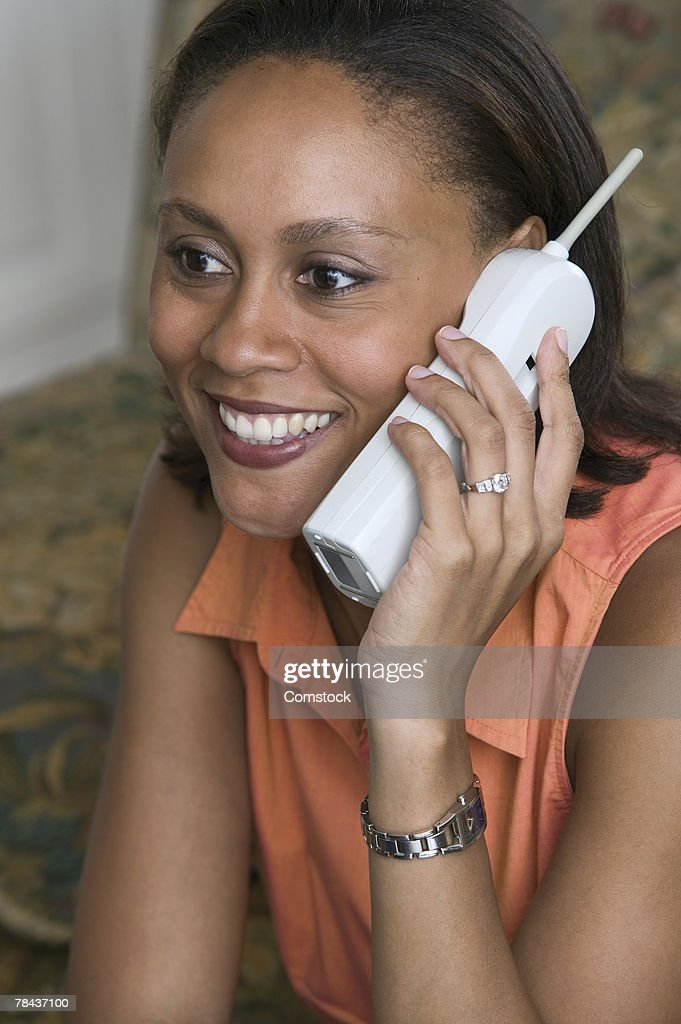 Woman on cordless telephone : Foto de stock