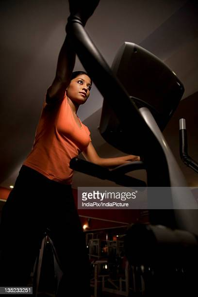 Woman on cross trainer