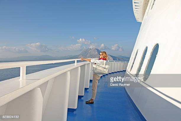 Woman on cruise boat looking out to sea