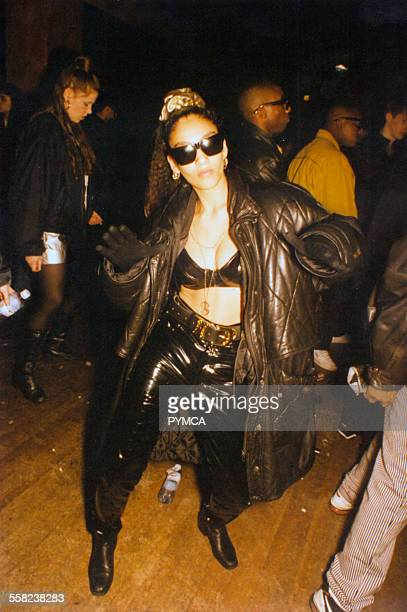 Woman on dancefloor wearing bulky leather coat at Voodoo Magic The Empire London 1995
