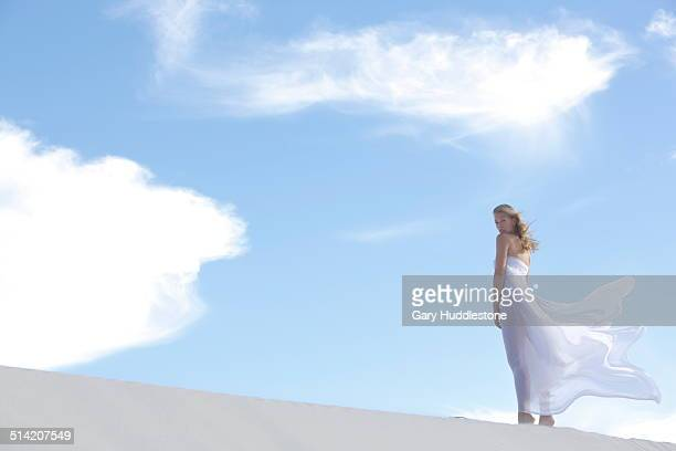 woman on dune in desert - blue dress stock pictures, royalty-free photos & images