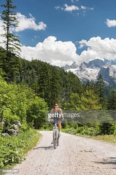 Woman on E-Bike Mountainbike in Nature, Dachstein Glacier