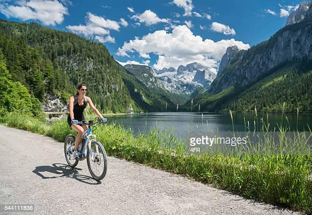 Woman on E-Bike Mountainbike in Nature, Lake Gosau, Dachstein Glacier