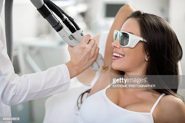 woman on epilation treatment - medical laser stock photos and pictures