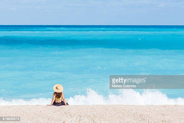 Woman on famous Myrtos beach. Kefalonia, Greece