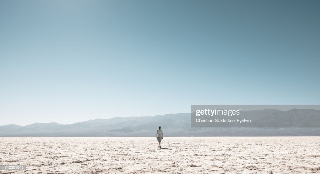 Woman On Field Against Clear Sky : Stock Photo