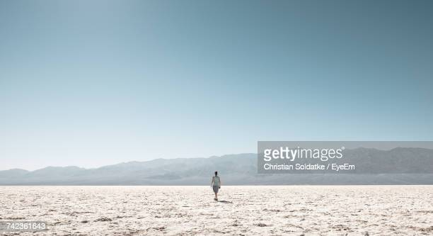 Woman On Field Against Clear Sky
