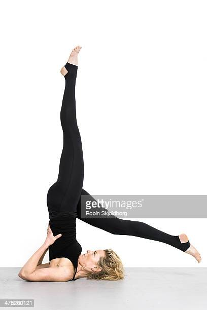 woman on floor doing yoga exercices - robin skjoldborg stock pictures, royalty-free photos & images