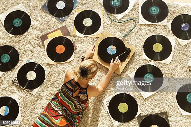 Woman on floor playing records