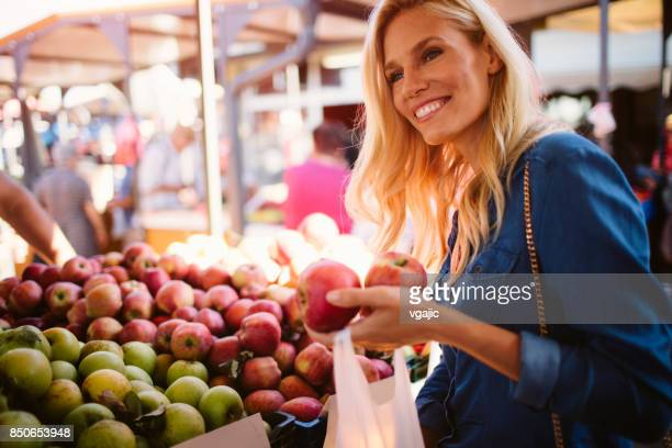 woman on greenmarket - apple fruit stock photos and pictures