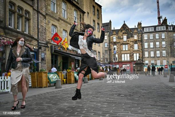 Woman on her hen day reacts as members of the public enjoy a drink in the Grassmarket as lockdown measures are eased on April 26, 2021 in Edinburgh,...