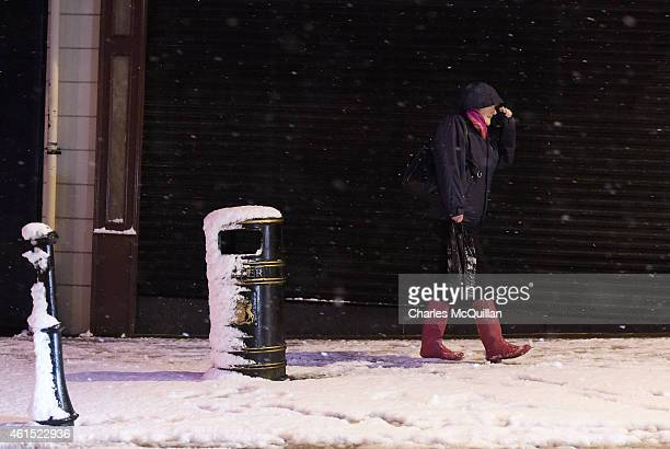 A woman on her way to work walks through the snow on January 14 2015 in Antrim Northern Ireland The province experienced heavy snowfall as a cold...