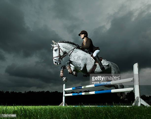 woman on horse jumping