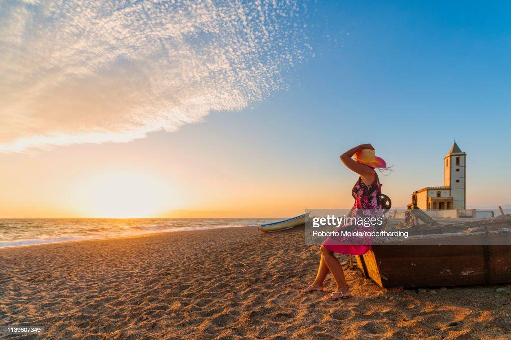 Woman On Iglesia De Las Salinas Beach At Sunset In Cabo De Gatanijar