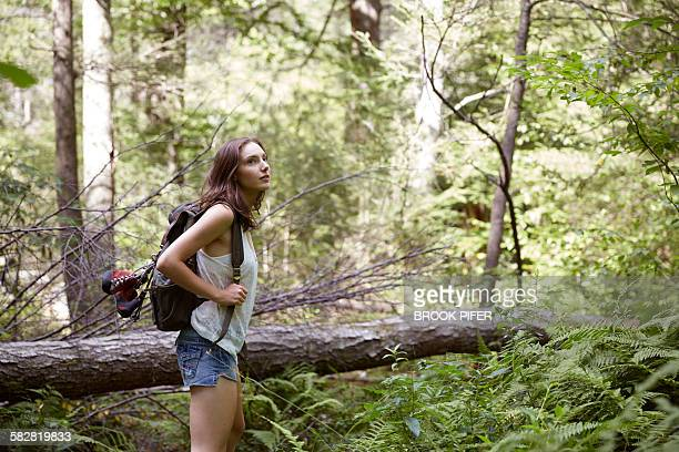 woman on journey exploring nature on hike - hot pants stock-fotos und bilder