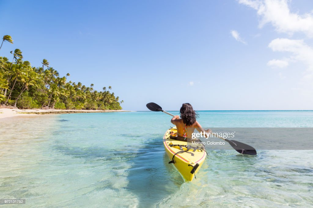 Woman on kayak near beach in a tropical island, Fiji : Stock Photo