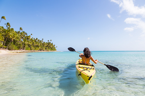 Woman on kayak near beach in a tropical island, Fiji - gettyimageskorea