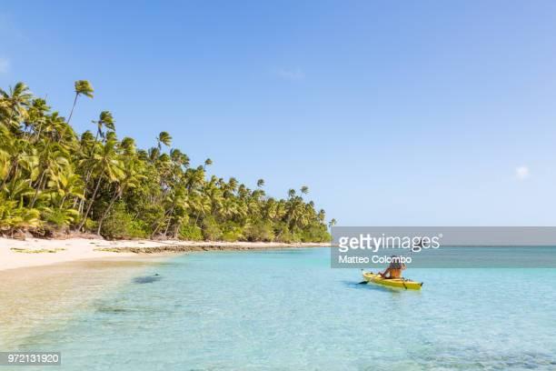 Woman on kayak near beach in a tropical island, Fiji