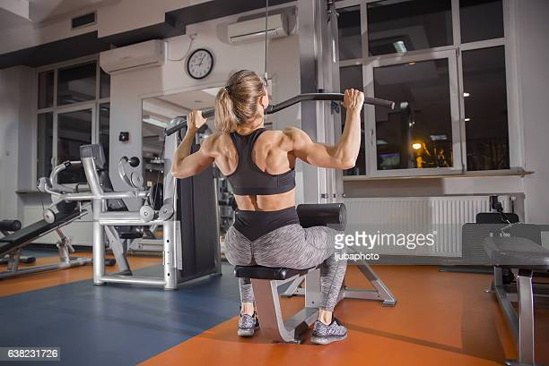 woman on lat machine in the gym - black female bodybuilder stock photos and pictures