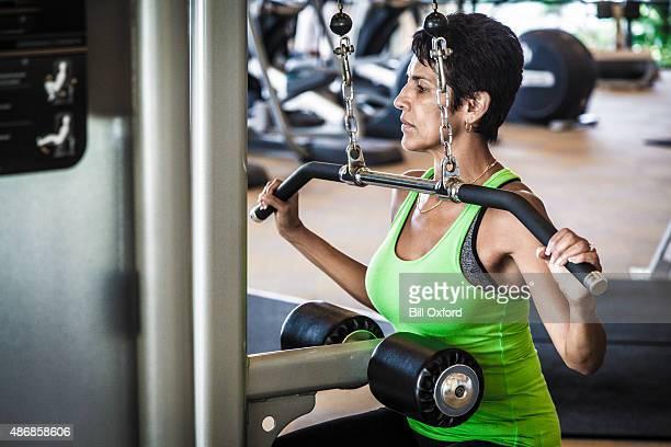 Woman on lat machine