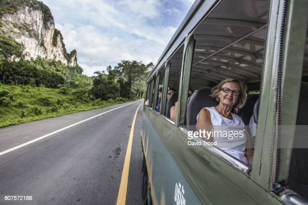 Woman on local bus in Thailand