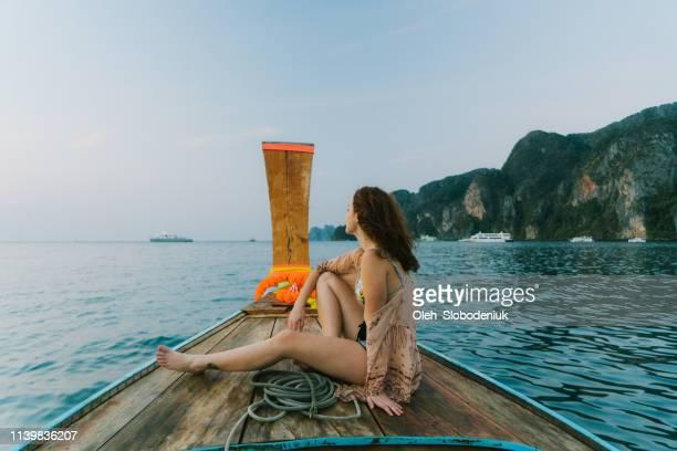 Woman on long-tail boat near Koh Phi Phi Island