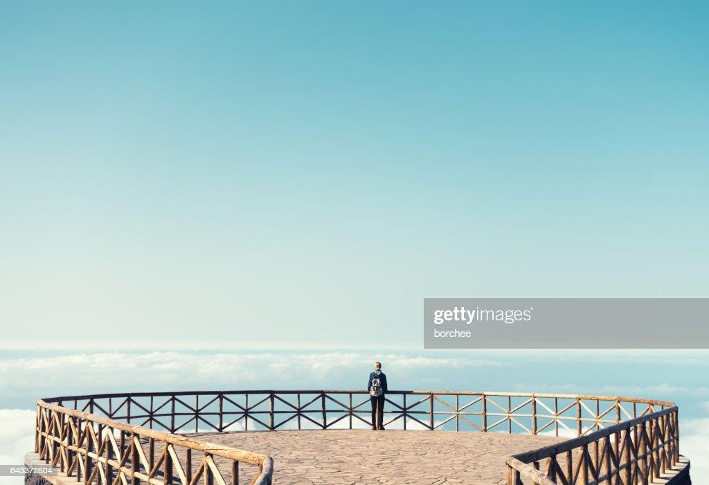 Young woman enjoying the great outdoors on Madeira island. Image was taken on the view platform (Miradouro do Paredão) by the road from Pico do Areeiro to Eira do Serrado.
