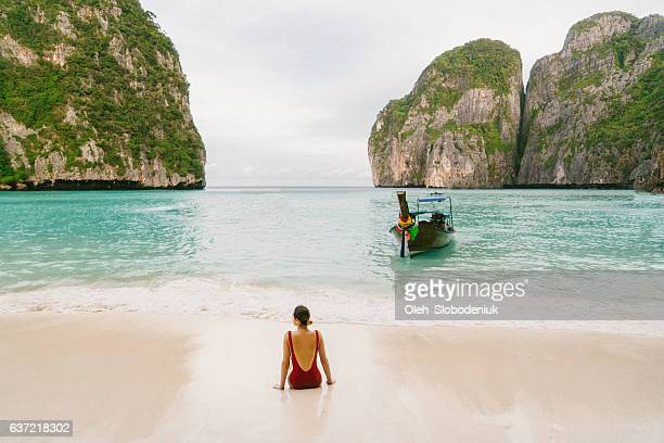 woman on maya bay beach - phi phi islands stock-fotos und bilder