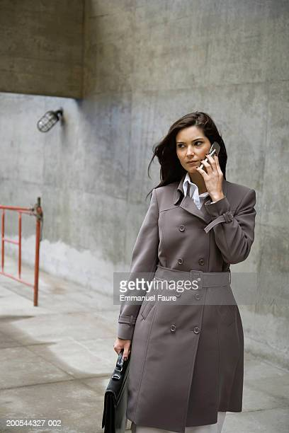 Woman on mobile phone in concrete area