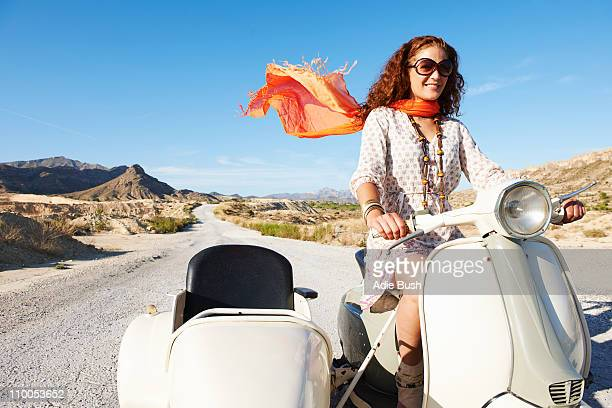 Woman on motorbike with sidecar