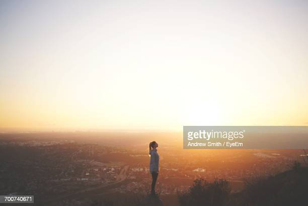 woman on mountain at sunset - clear sky stock pictures, royalty-free photos & images