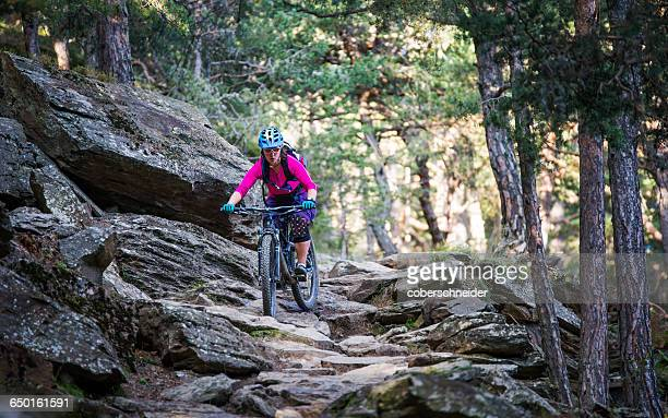 Woman on mountain bike in forest, South Tyrol, Italy