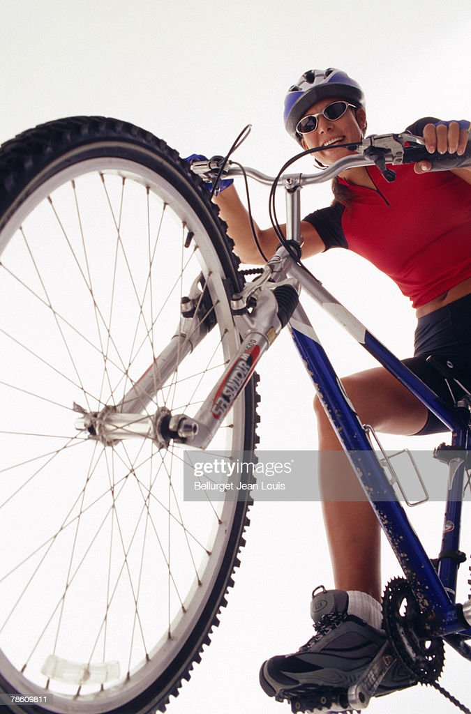 Woman on mountain bike : Stock Photo