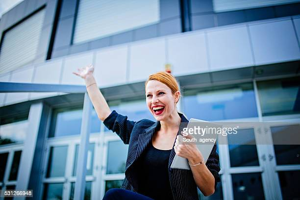 Woman on office building stairs