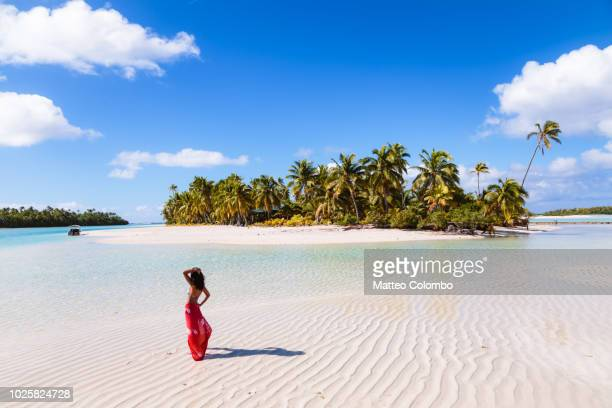 woman on one foot island, aitutaki, cook islands - polynesia stock pictures, royalty-free photos & images