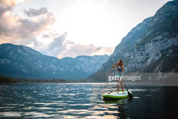 woman on paddleboard enjoying solitude and beauty in nature - unesco world heritage site stock pictures, royalty-free photos & images