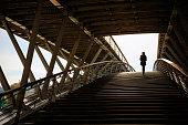 Woman on Passerelle Solférino footbridge in Paris, France.