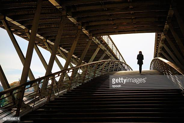 Woman on Passerelle Solférino footbridge in Paris, France.