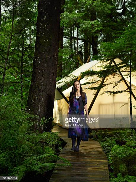 Woman on pathway outside of tent.