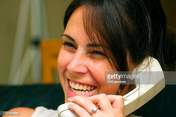 woman on phone smiling - niece stock photos and pictures
