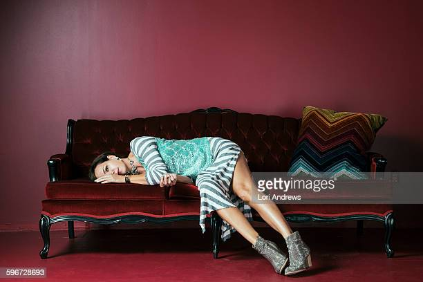 woman on red sofa - lori andrews stock pictures, royalty-free photos & images