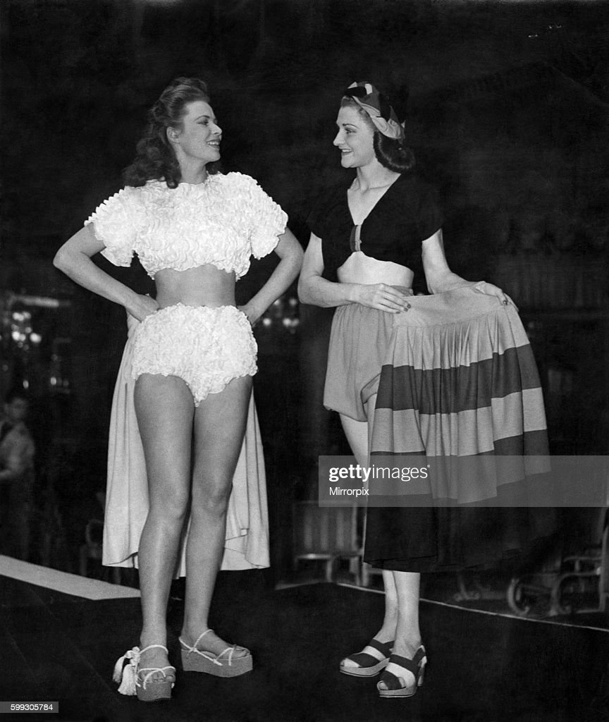 Clothing - Women - Beachwear Girl on left wears a white 'Rumba' brassiere top and briefs / panties, and holds her yellow : News Photo