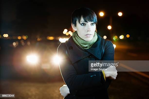 Woman on road at night
