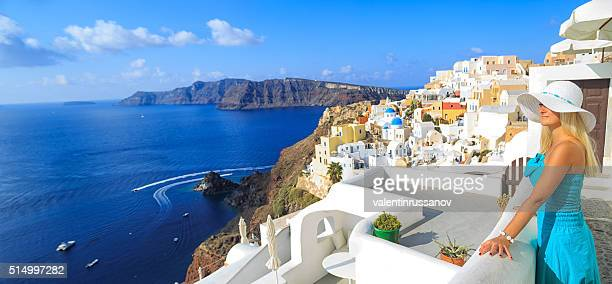 Woman on rooftop terrace of town Oia at Santorini