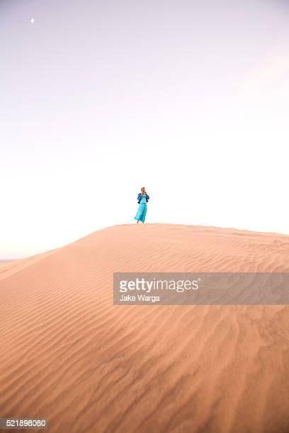 woman on sand dune, walvis bay, namibia - jake warga stock pictures, royalty-free photos & images